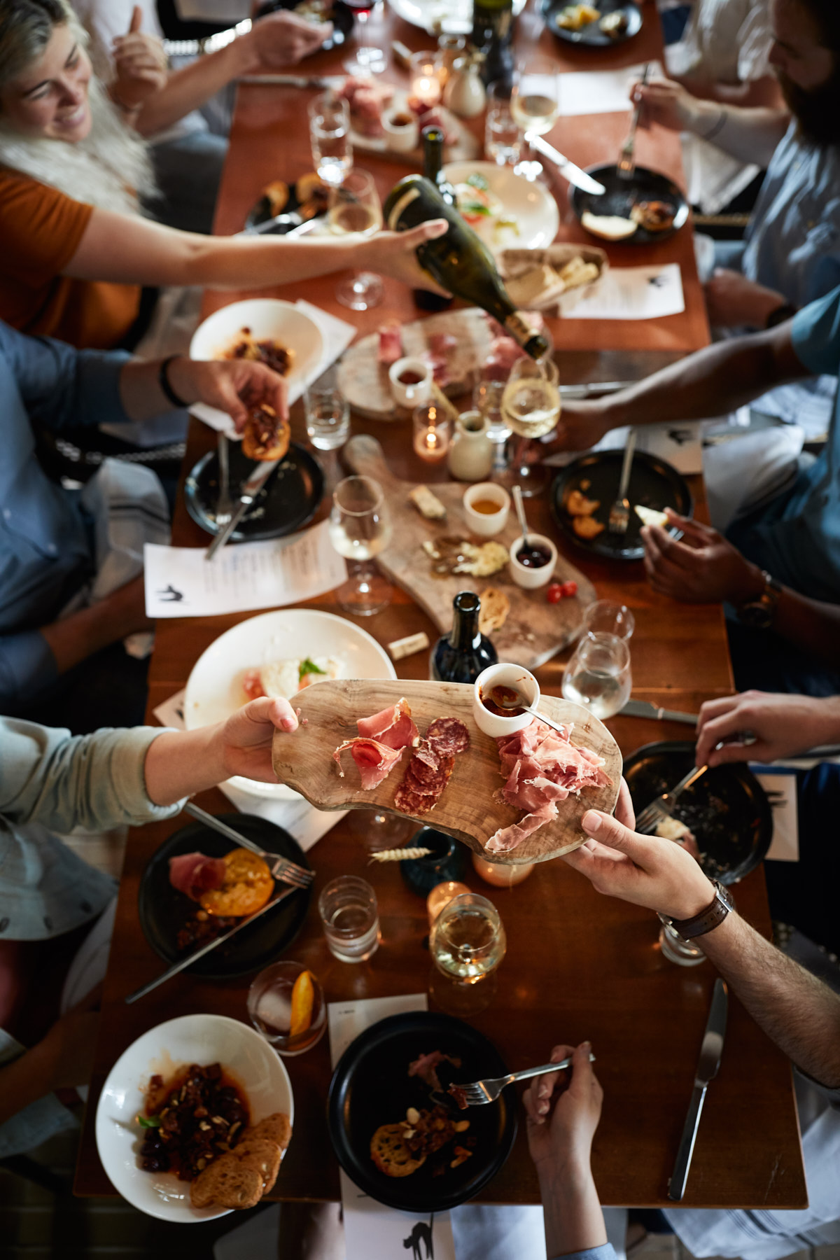 Jody Horton catches the festivities from above: a table full of food, wine, and people