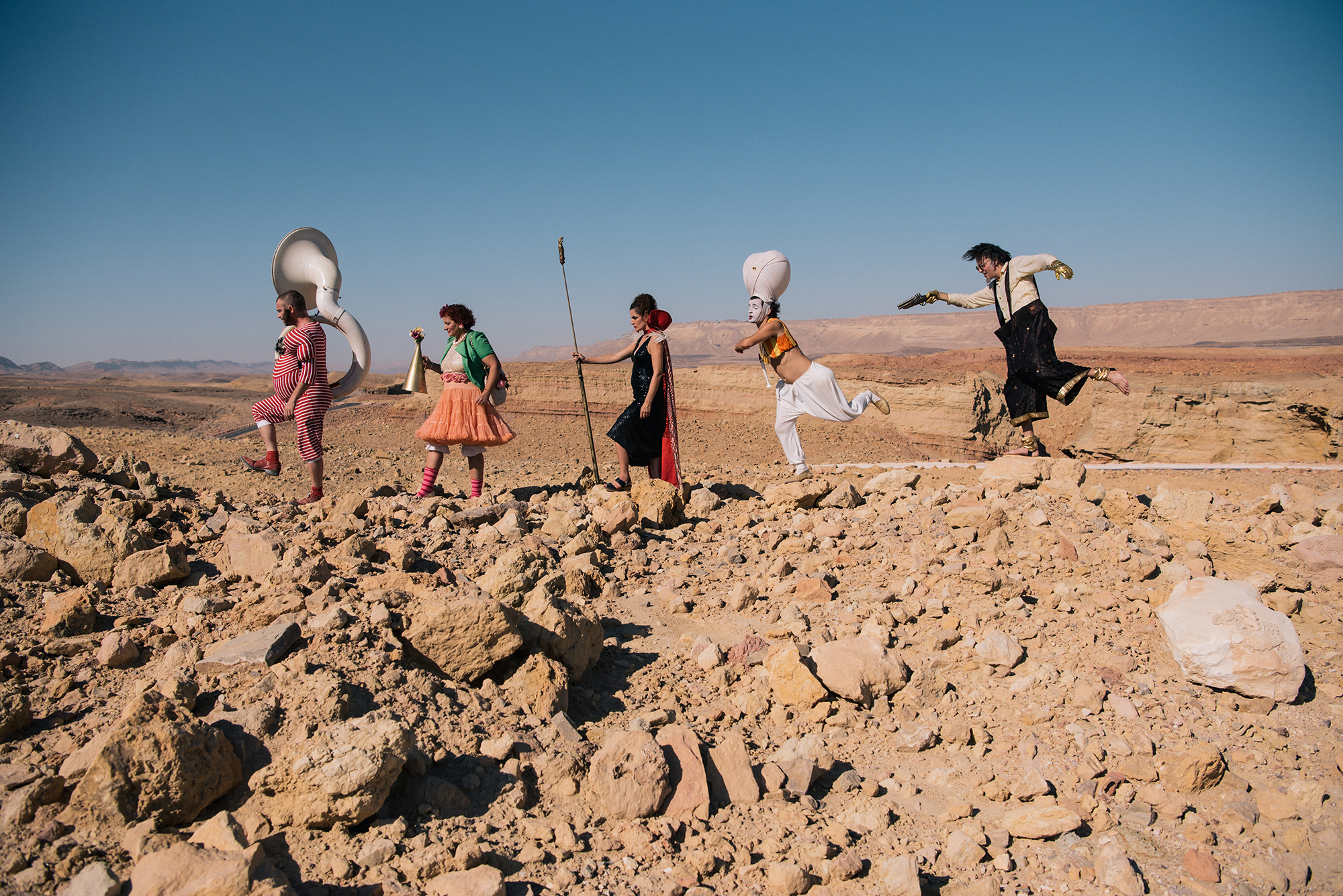 Arik Shraga photographs the epitome of a traveling circus with DAVAI Theater Group as they hop over sandy rocks in the desert