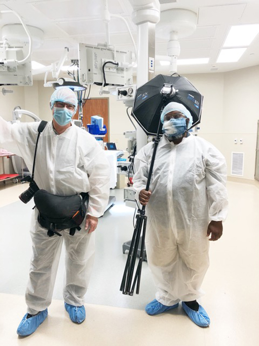 Art Meripol with assistant behind the scenes in full PPE at Grandview Medical