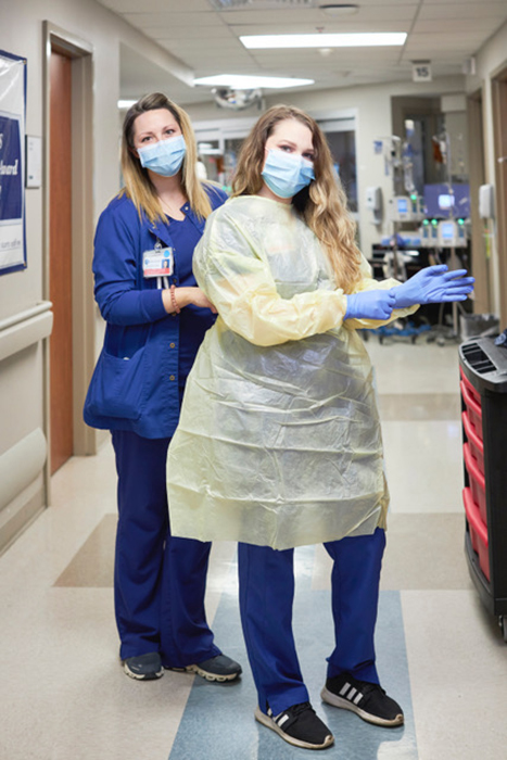 Art Meripol photographs support suiting up at Grandview Medical