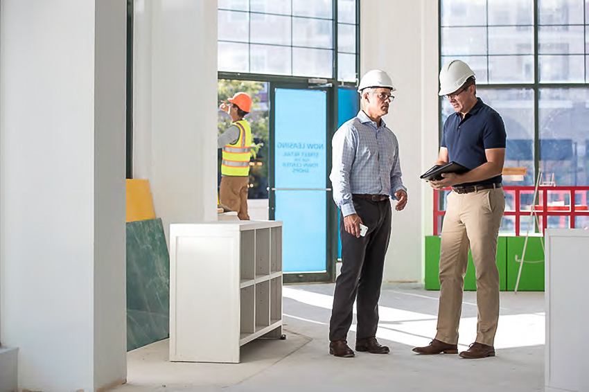 Image of of a Nationwide Insurance Agent and a small business owner in a commercial space under construction.