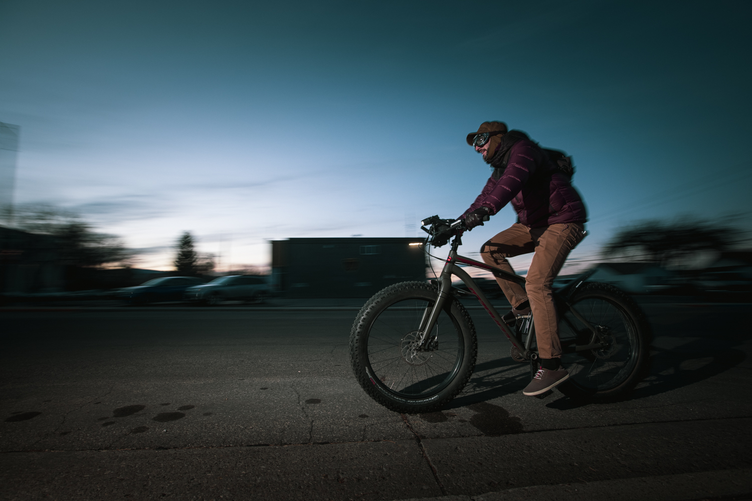 Craig Okraska photographs a man at dusk zooming by on his bike for the LOR Foundation