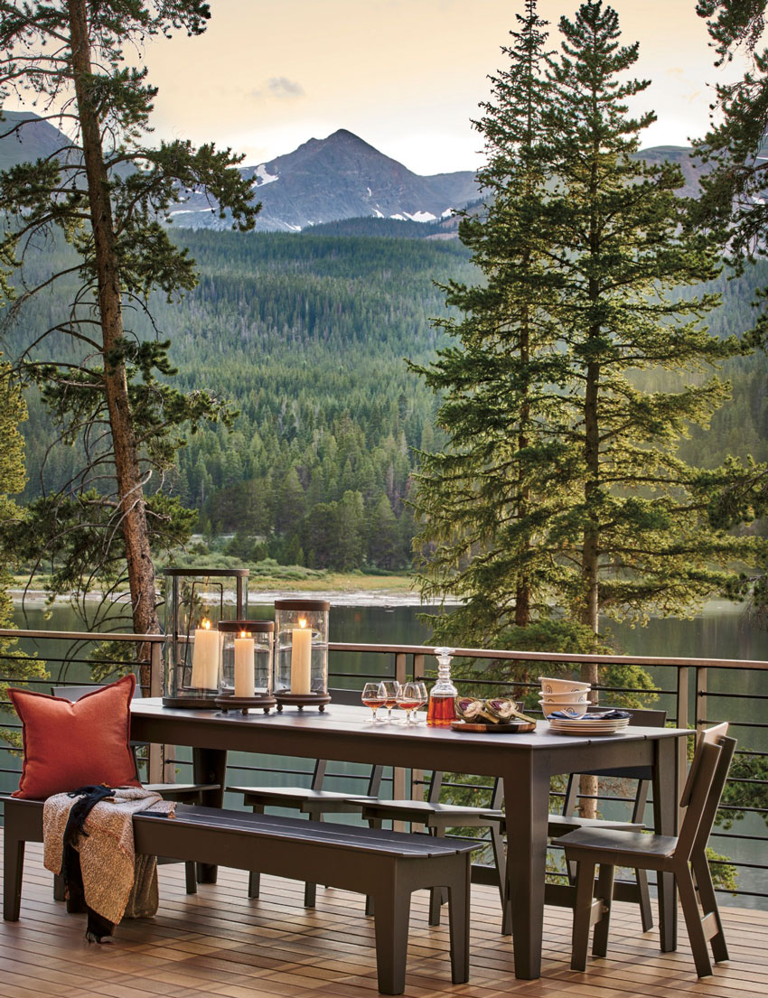 David Patterson shoots for Luxe Magazine from the house's deck, facing the water and a tree-covered mountain