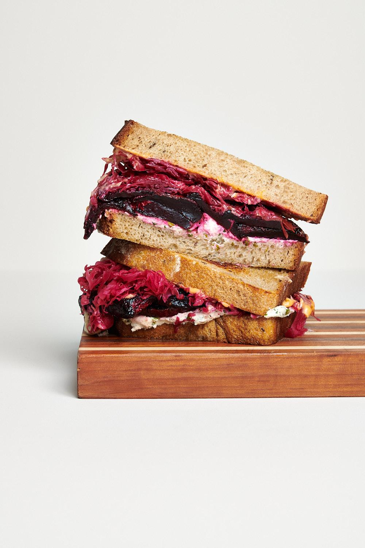 Dina Avila photographs a scrumptious beet sandwich on a white backdrop for Fermenter