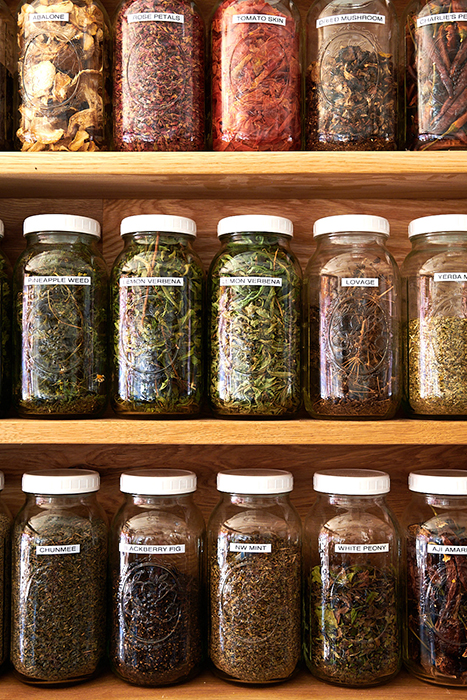 Dina Avila takes close up image of spices in jars for Fermenter