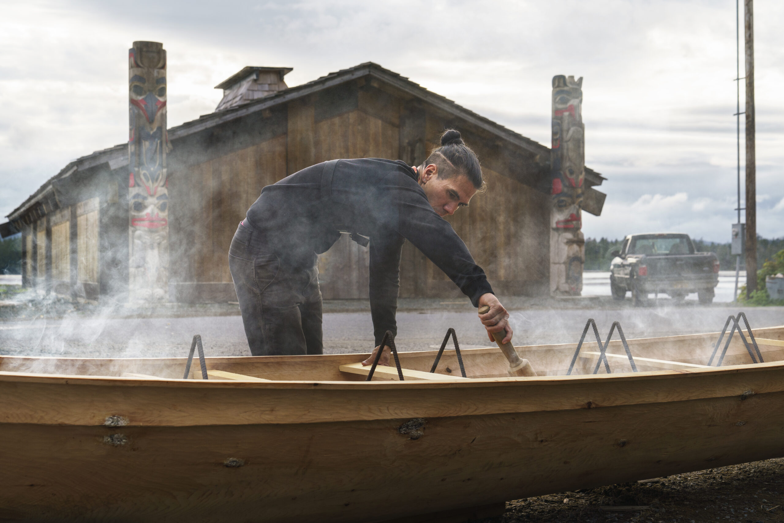 An artist works on a boat. Photography by Fernando Decillis for Smithsonian Magazine