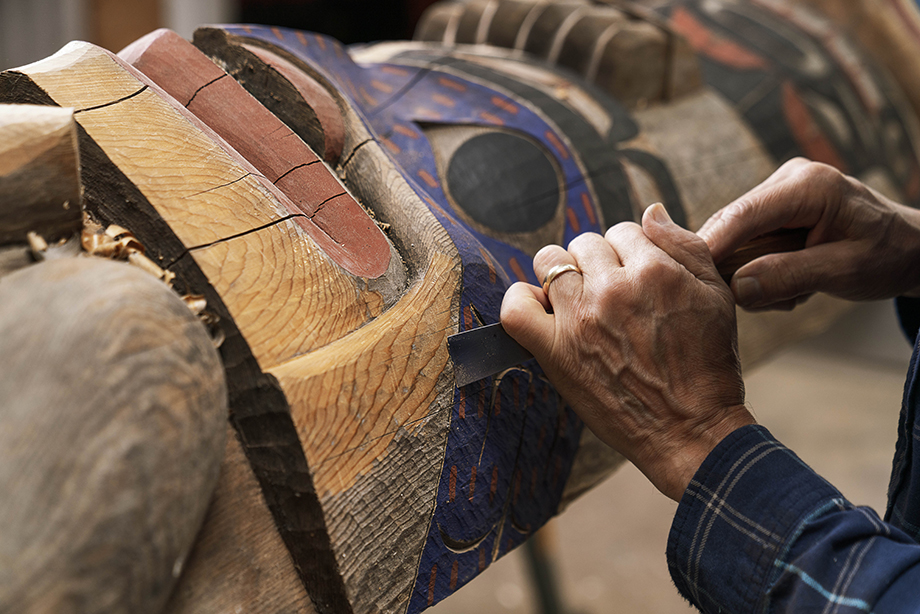 Close up image of artist carving. Photography by Fernando Decillis for Smithsonian Magazine