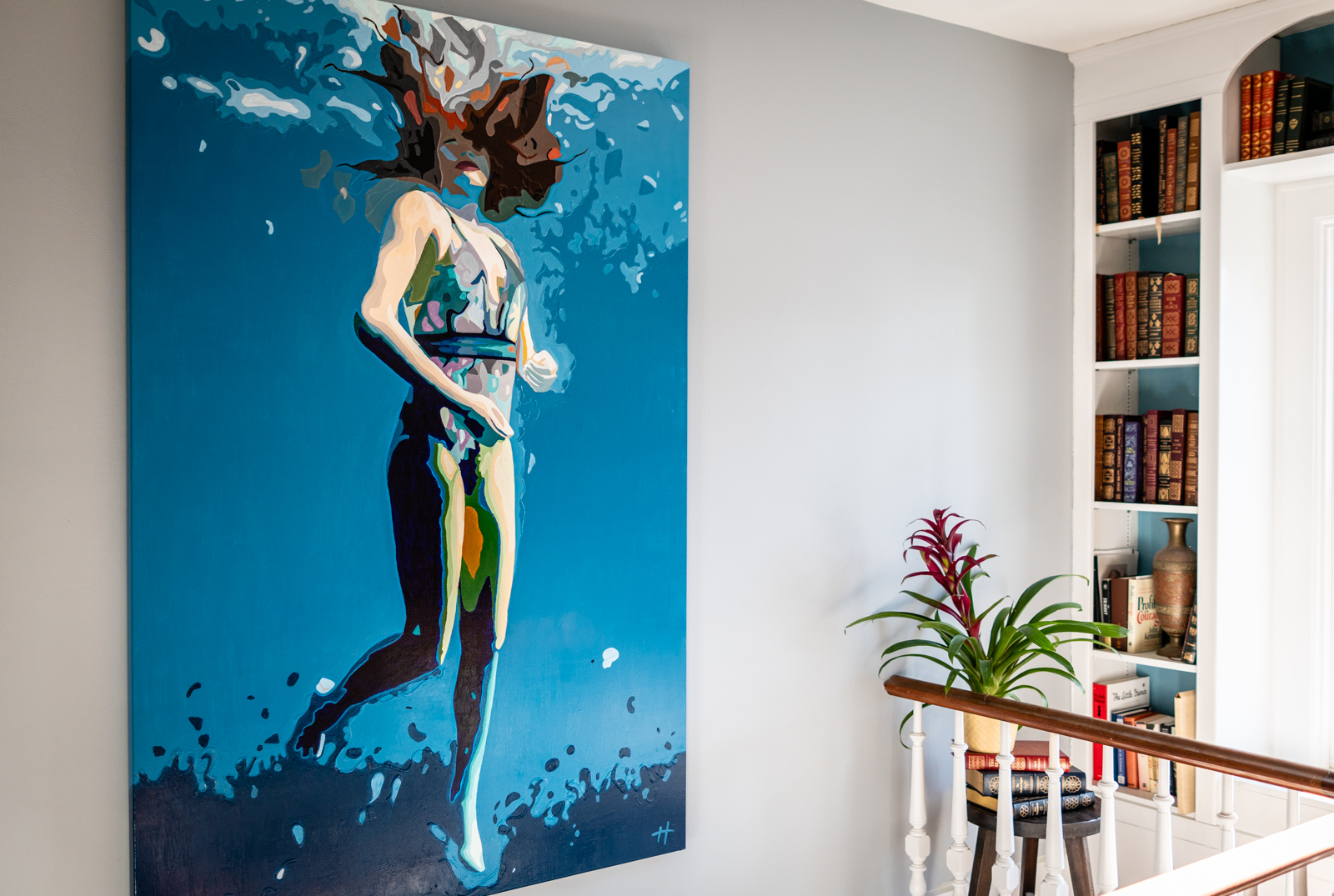 Heather Perry's underwater painting of a woman suspended in the water, her hair floating above her head, hanging on the wall