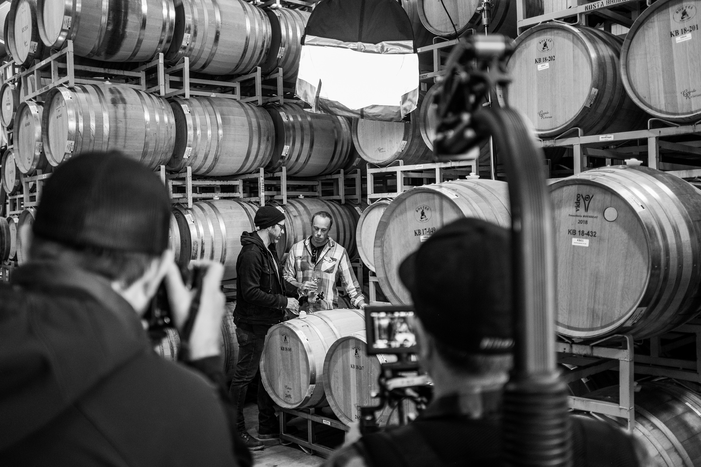 Rachid's crew shoot Mike and Nico amidst KB wine barrels