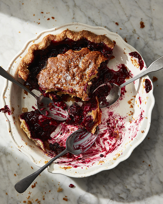 Mark Weinbergs photo of a mostly devoured pie with three spoons that have been scraping the berry pie out of the pie plate