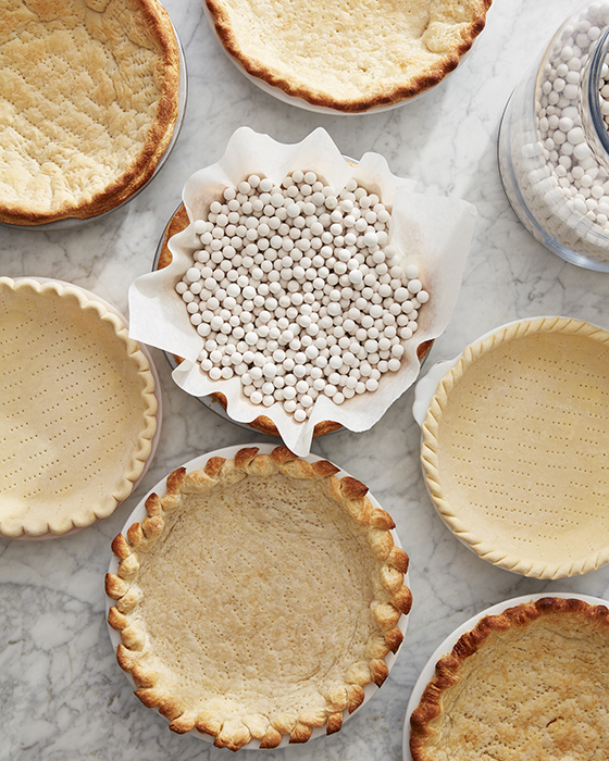 Mark Weinberg photographs pie crusts some filled with baking weights others empty with all different designs and bakes