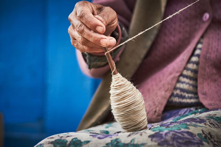 Mark Katzman's Real and Raw Travels through India for FES - Woman making yarn for clothing.