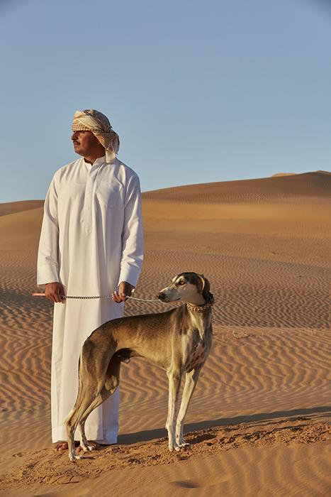 Martin Westlake photographs dog and handler in the desert for DestinAsian