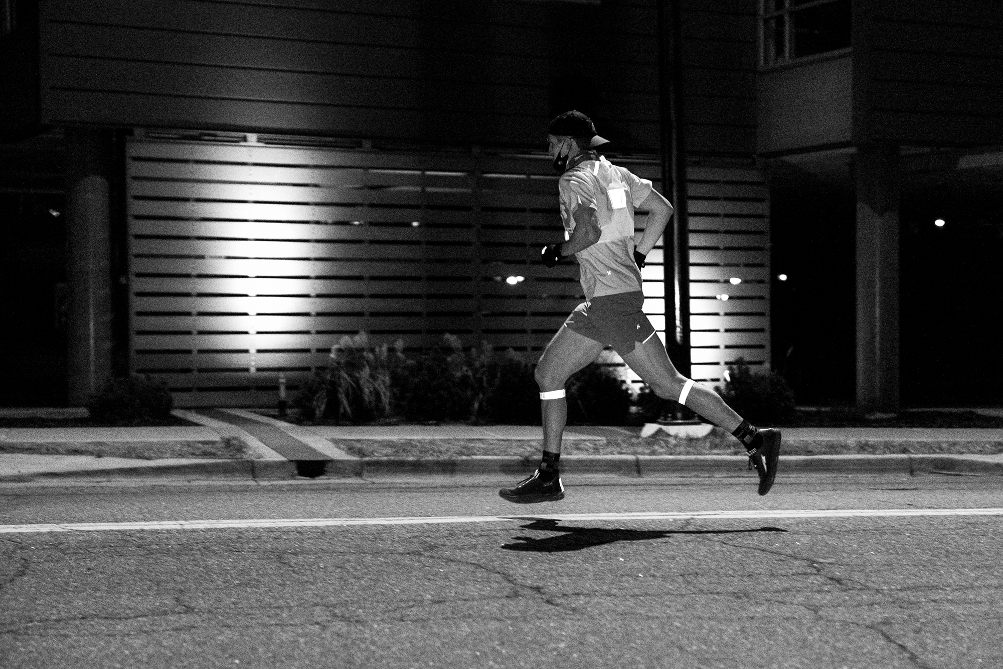 Matt Trappe photographs a runner in the dark while hes still in the air for TTB