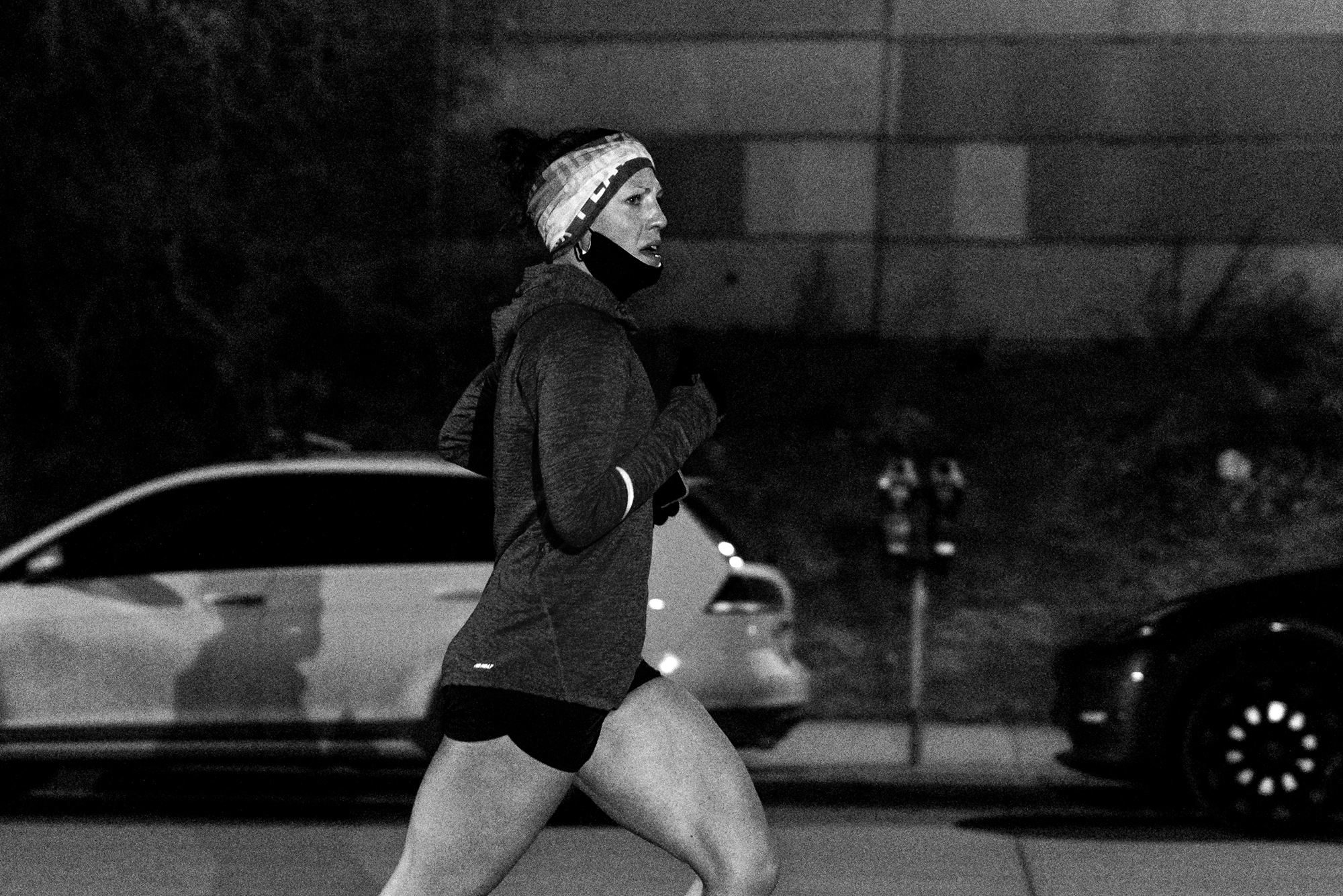 Matt Trappe photographs female runner in the dark for TTB in Denver