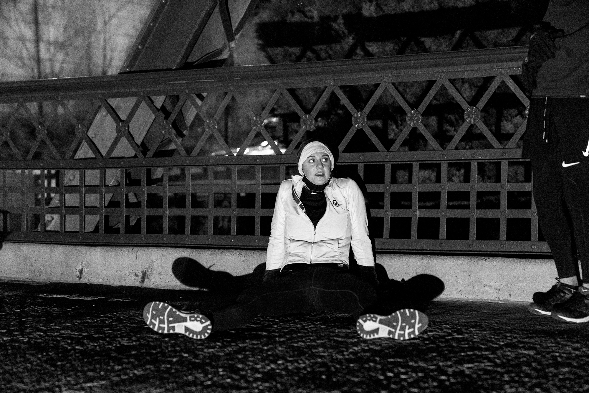 Matt Trappe photographs exhausted runner at the end sprawled out on the pavement for Take the Bridge in Denver