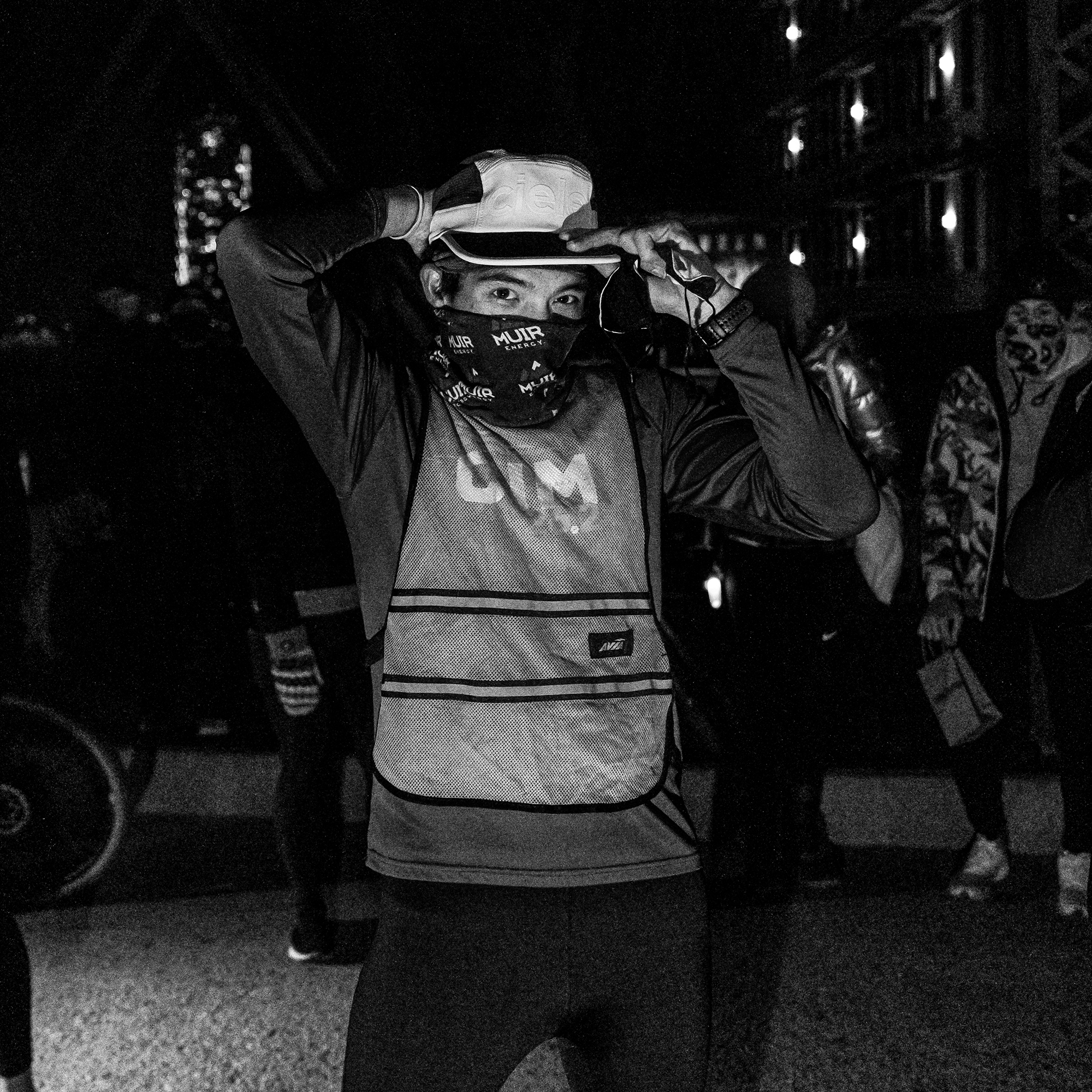 Matt Trappe photographs a masked runner looking fly in his gear for Take the Bridge in Denver