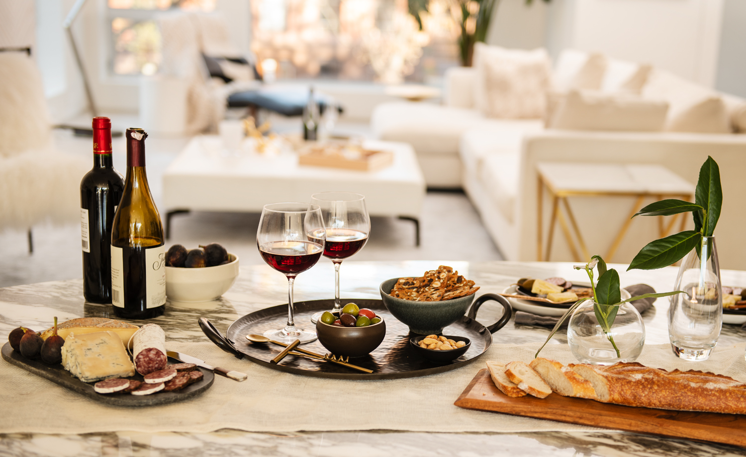 Wine and charcuterie tablescape in a modern kitchen. Shot by Michael Marquand for Modern Charcuterie.