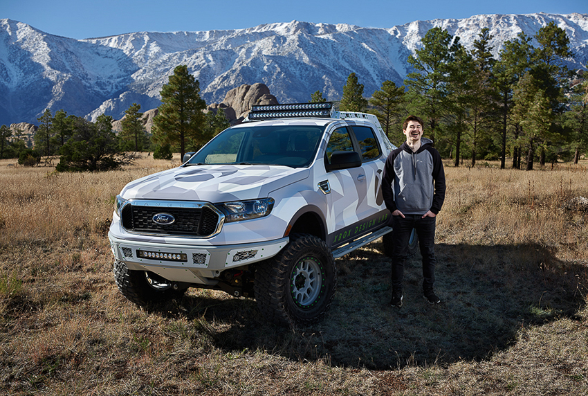 Nick Andrew standing beside Ford truck