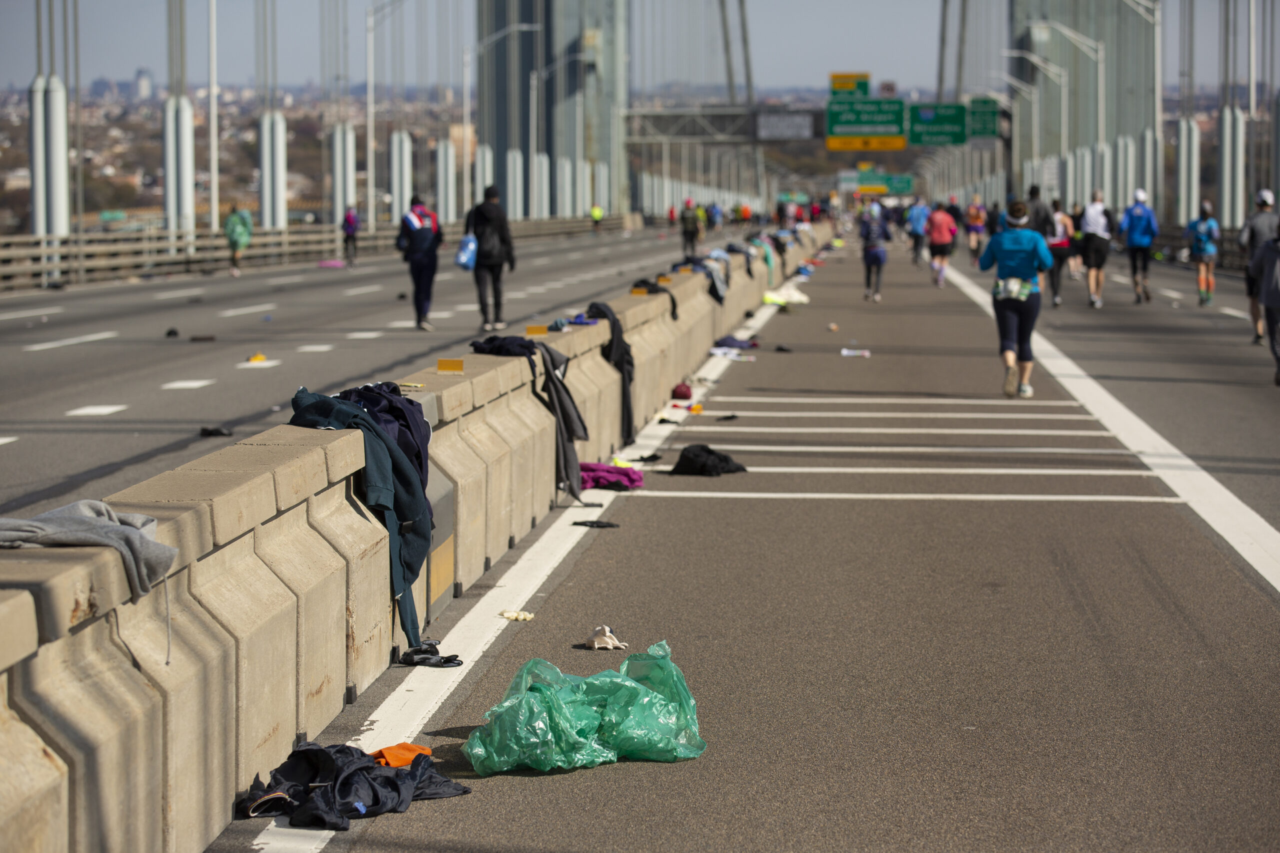 Ben Norman shows the marathon's aftermath of discarded running clothes on the Verrazano Bridge