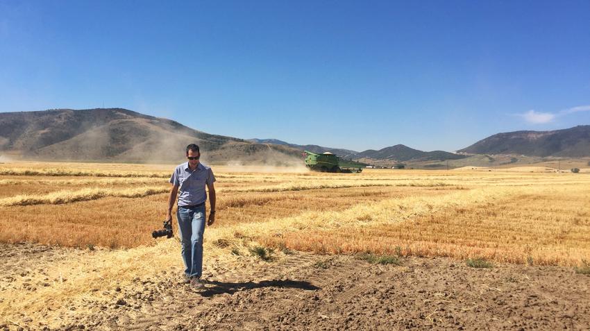 John Valls behind the scenes in a barley field