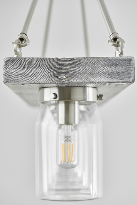 William DeShazer photographs silver light fixture for Hunter Fan Company