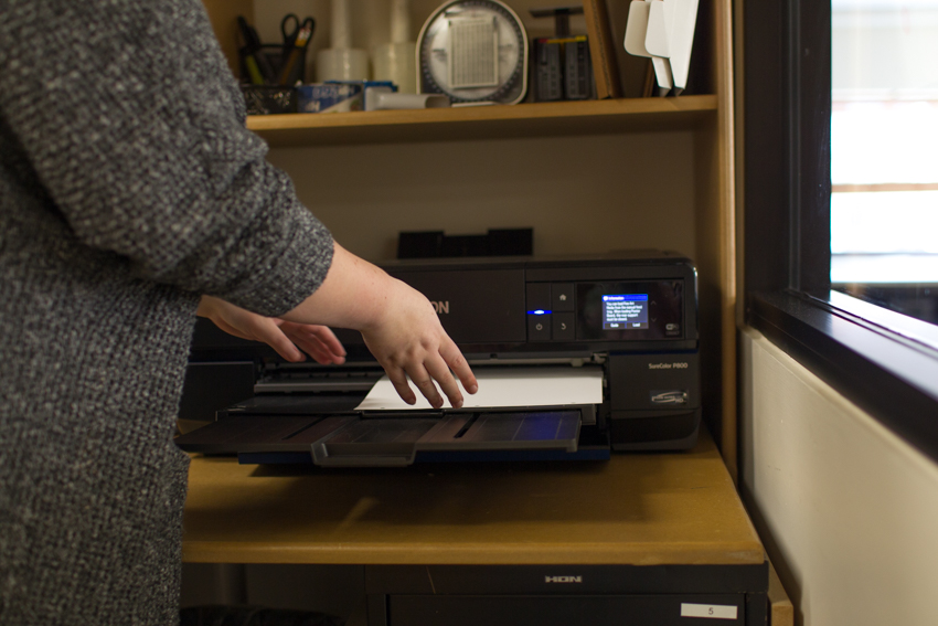 Wonderful Machine photo editor Molly Glynn loads paper into Epson P800 printer