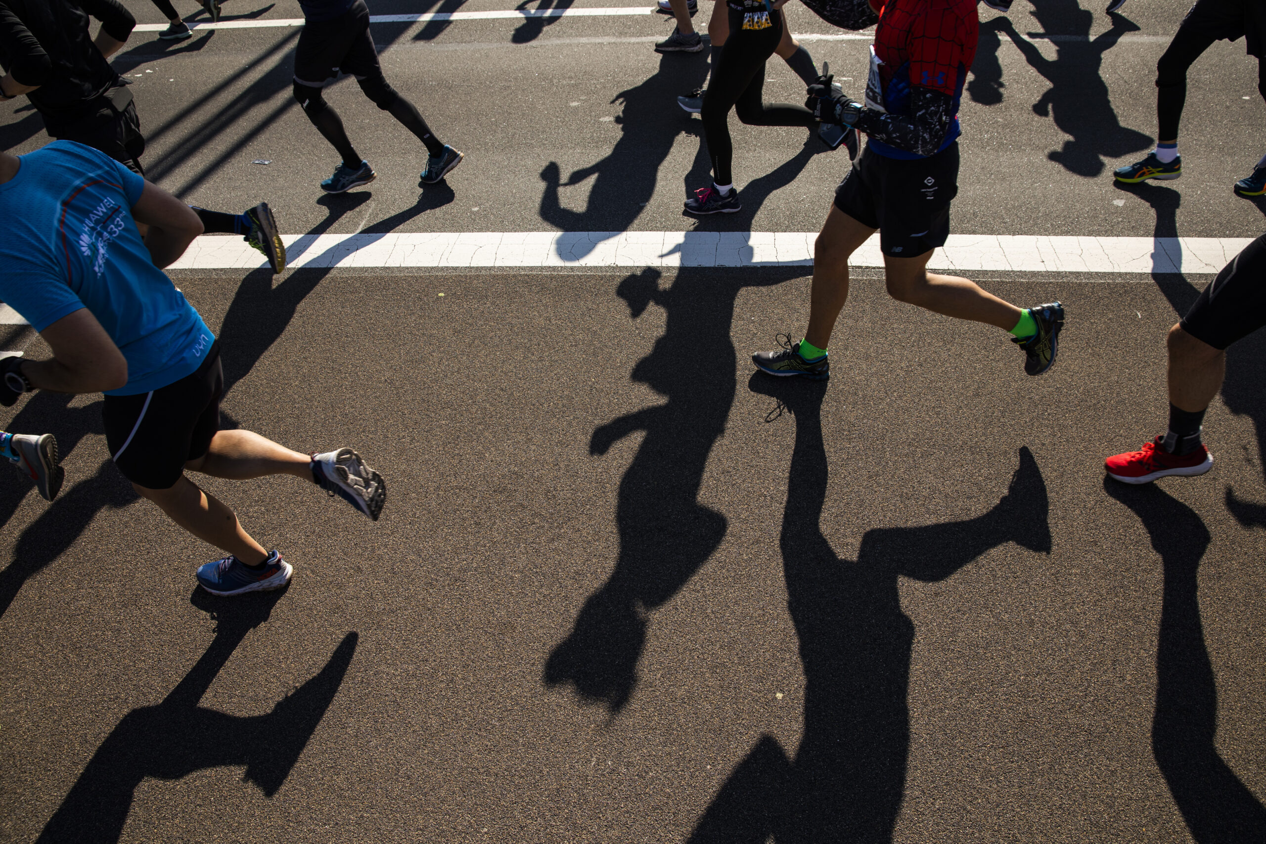 Ben Norman's shot that made the front page stands alone; no one runner is featured and there are as many shadows as bodies