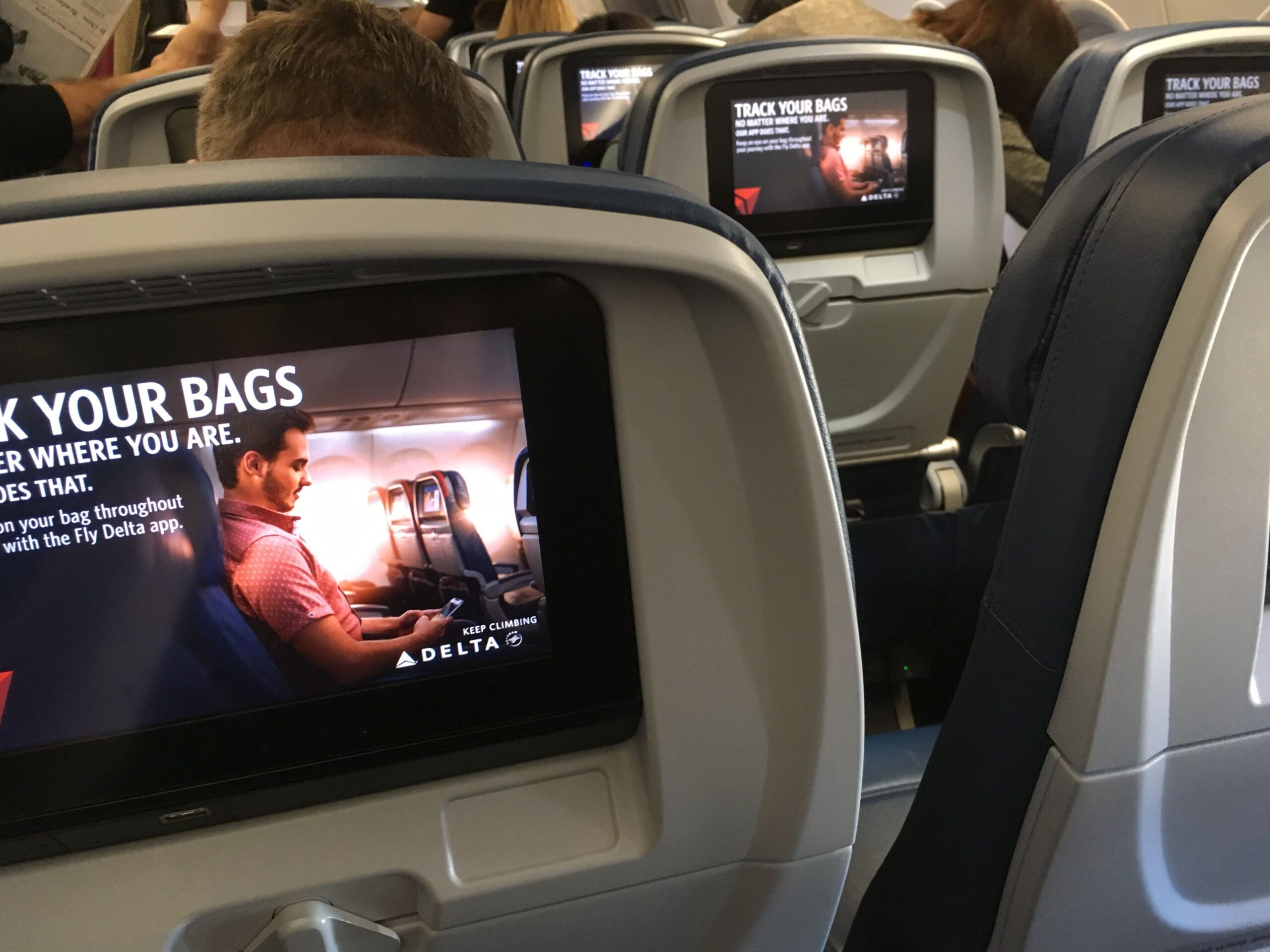 John Fulton's photo shows the in-flight video screens on the back of plane seat headrests