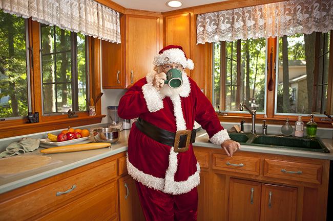 Santa Claus having his morning coffee