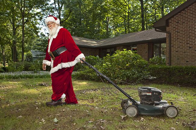 Santa Claus mowing the lawn
