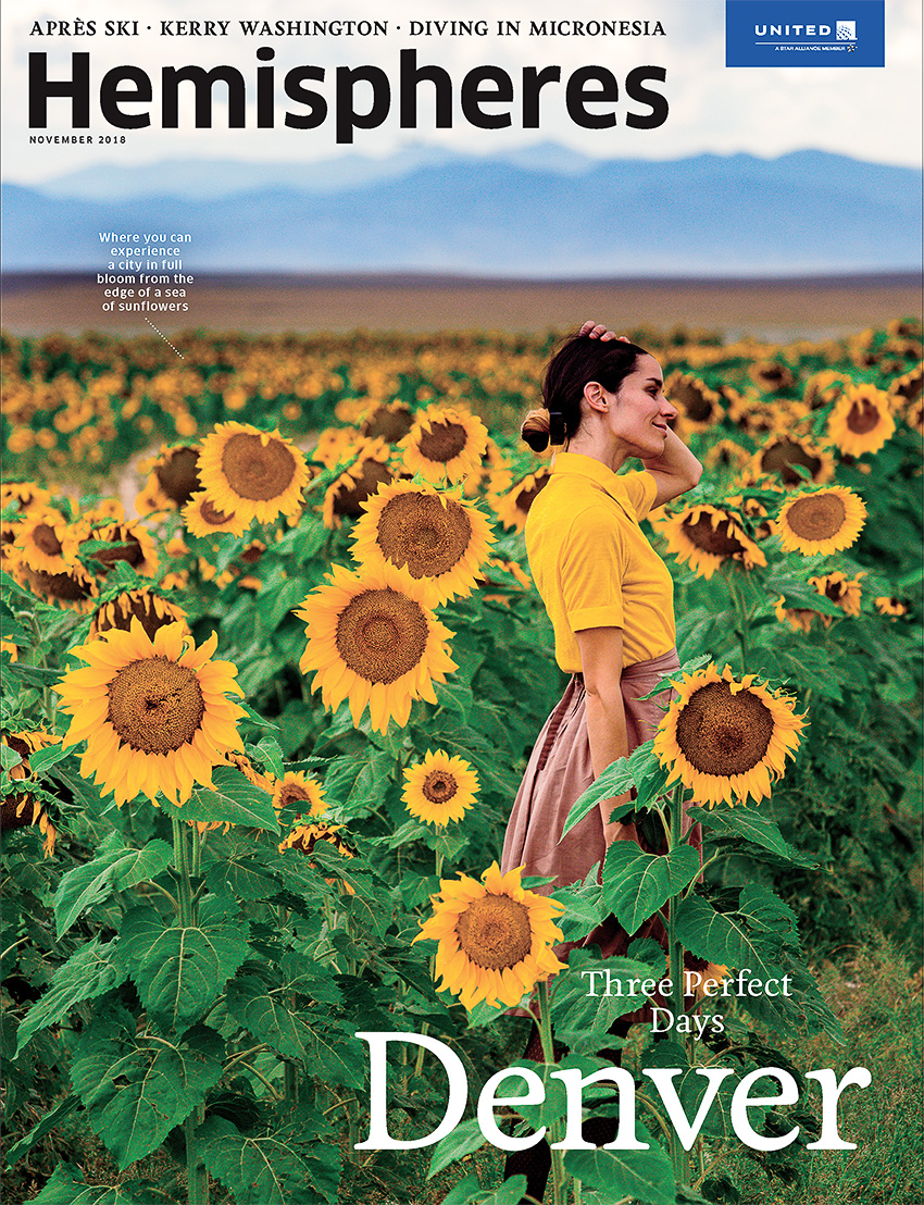 Hemispheres cover of woman in sunflower field shot by Rebecca Stumpf