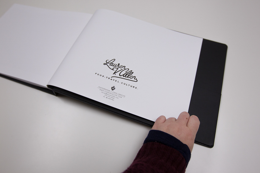 Lauren V. Allen's portfolio cover and photo editor Molly Glynn's hand