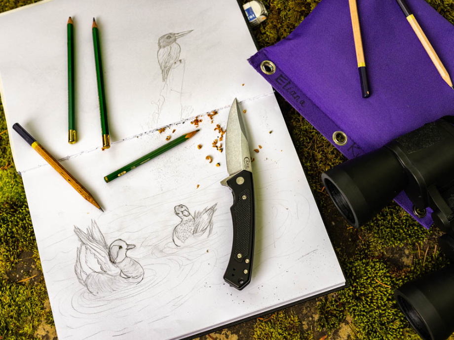 Pencils sharpened by knife on top of mallard drawing shot by Ed Sozhino for Case Knives