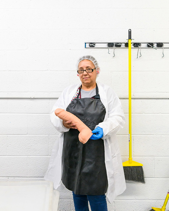 An employee with a Doc Johnson dildo, at the factory in Los Angeles photography by Alastair Philip Wiper