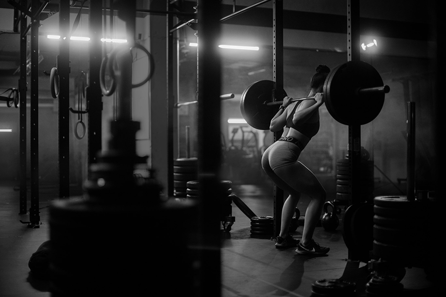 Carrie Xu at a gym lifting weights. Photographed by Albert Law.