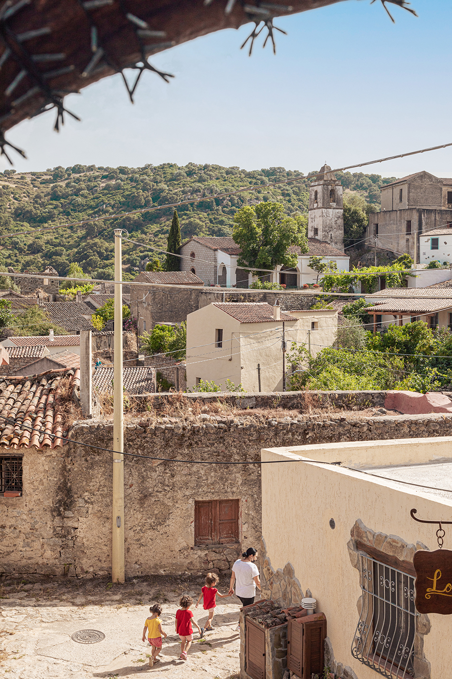 Medieval homes on the hill in Lovelle Sardinia shot by Alberto Bernasconi for Enjoy magazine