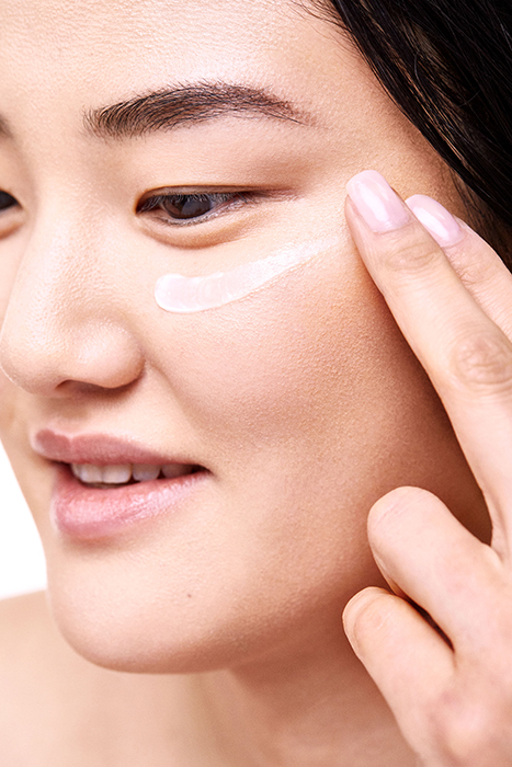 A model showcases Clarins Total Eye Lift Product. Photographed by Andrew Day.