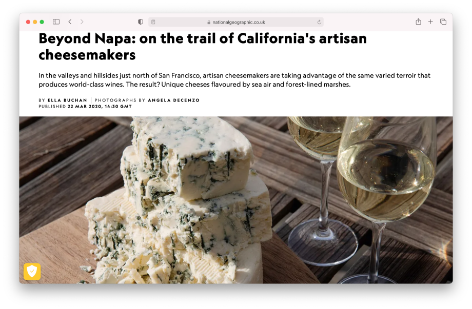 Tear sheet of National Geographic Traveller Food magazine website featuring blue cheese next to white wine shot by Angela DeCenzo
