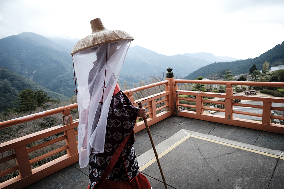 Saito Fumiko,  wearing Haein Ishyo at  Nachi Falls in Nachikatsuura, Wakayama Prefecture. Kumano Nachi Taisha Grand Shrine, Nachisan Seiganto-ji Temple and Nachi Waterfall The highlight of Wakayama tour is to visit the greatest / highest waterfall of JAPAN, Nachi Waterfall (133 m by one drop).Kumano Nachi Taisha Grand Shrine is one of the final destinations of Kumano Kodo(ancient routes). Nachi Waterfall is falling down divinely from the primeval forest.This is a stunning cultural landscape that reflects the strong traditional of Shinto-Buddhist syncretism. Text and photographs by Ben Weller.