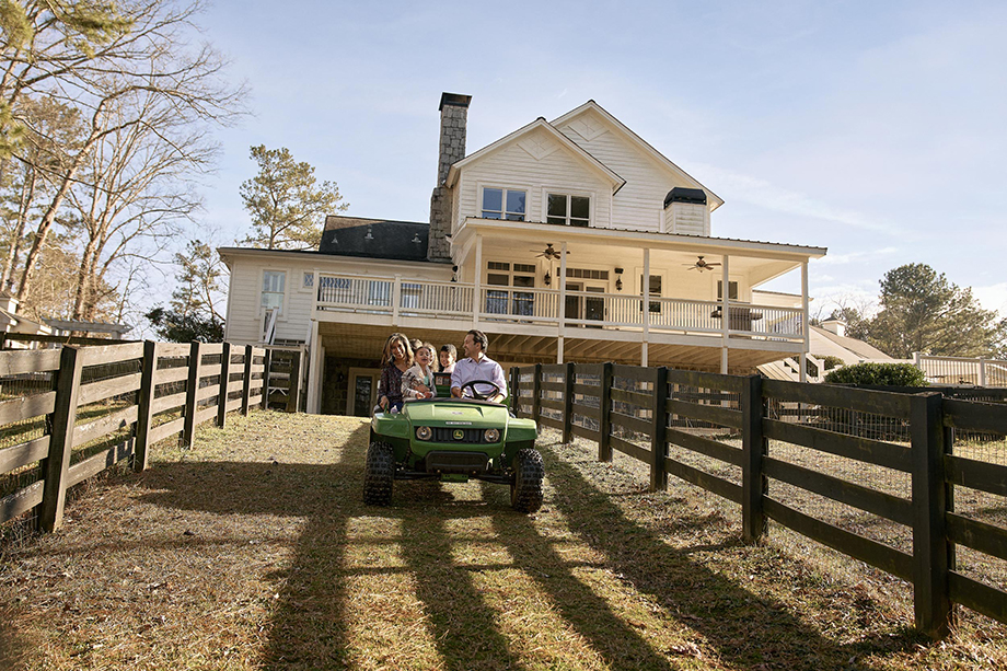 A family on a tractor in the suburbs photographed by Ben Rollins