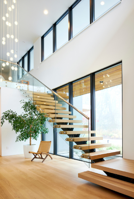 Light coming in on the floating staircase in the Molina house built by GSW Architects shot by Bill Purcell for the Wall Street Journal
