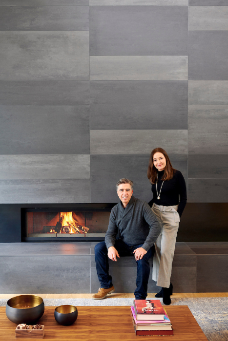 The Molina family in front of living room fireplace built by GSW Architects shot by Bill Purcell for the Wall Street Journal