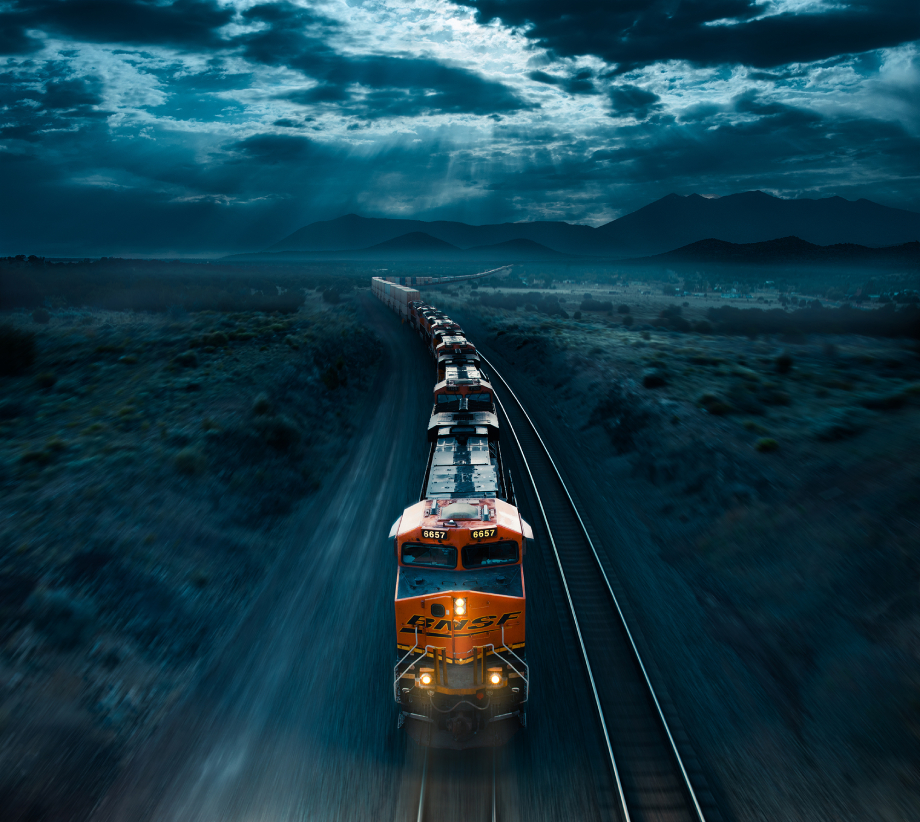 Freight train under a moonlight sky shot by Blair Bunting