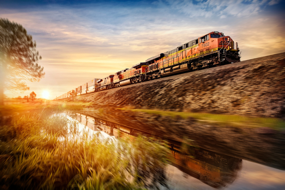 Freight train passing rural landscape shot by Blair Bunting