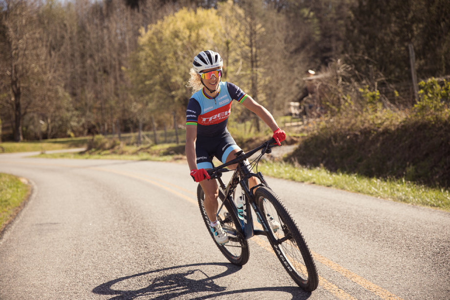 Jolanda Neff cycles down rural road shot by Brandon Clifton for Red Bull's The Red Bulletin.