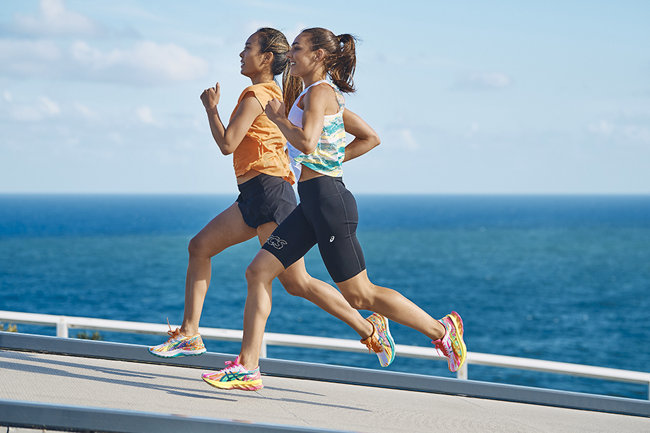 Brett Hemmings photographs two women at the beach run in ASIC's Color Injection Pack sneakers.