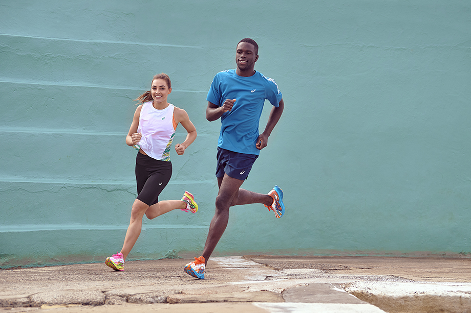Two runners against a bright blue wall for Asics photographed by Brett Hemmings