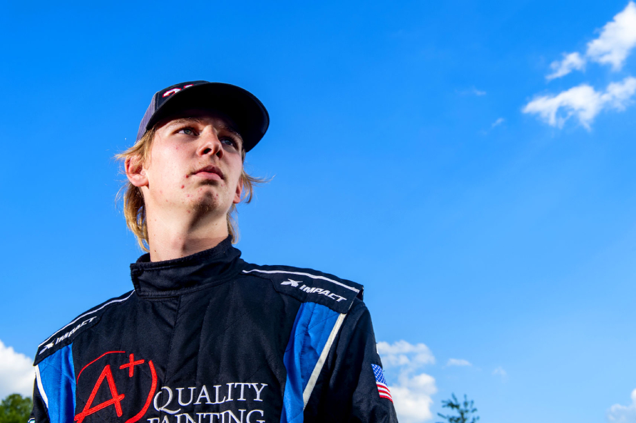 Young driver in front of an open blue sky at Wake County Speedway shot by Bryan Regan for Walter Magazine