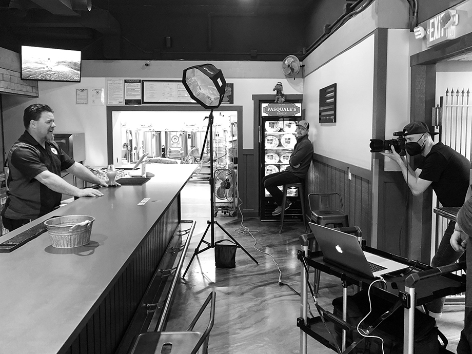 A behind-the-scenes image of CJ photographing James K.